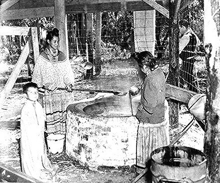 Two Seminole women cooking cane syrup, Seminole Indian Agency, Florida by Gardin 1941